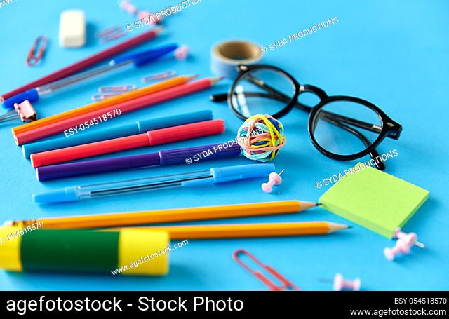 stationery or school supplies on blue background