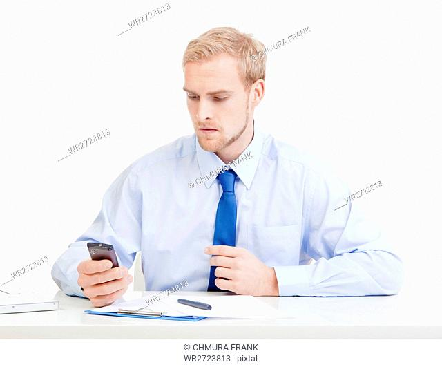 young man at office with mobile phone