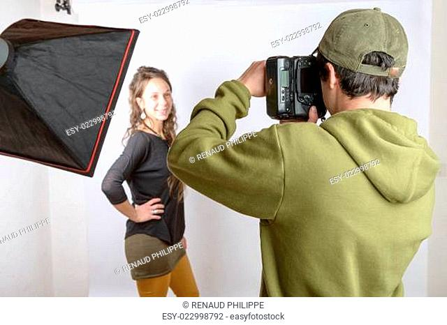 a photographer photograph his model