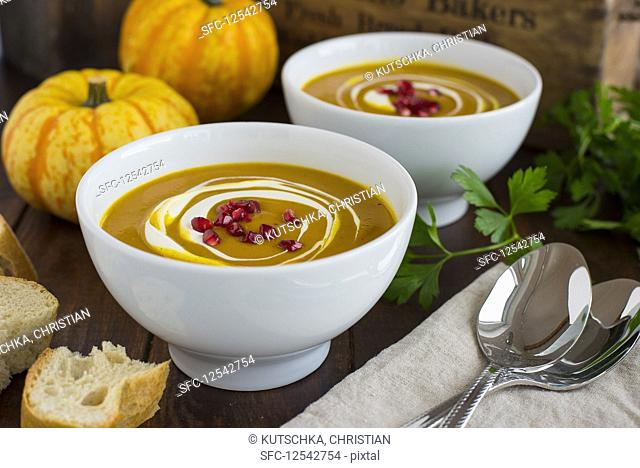 Cream of pumpkin soup with pomegranate seeds