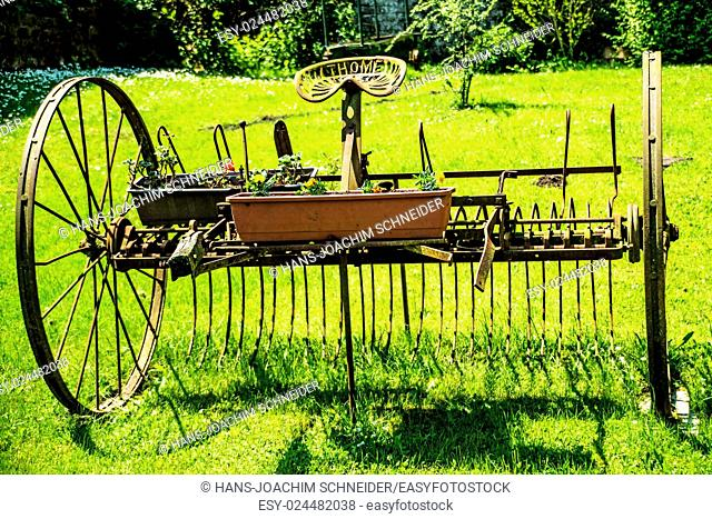 old hay turning machine