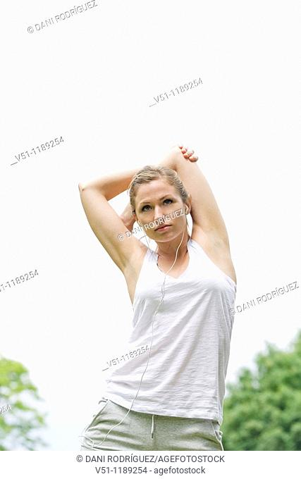 Blonde woman stretching in the park