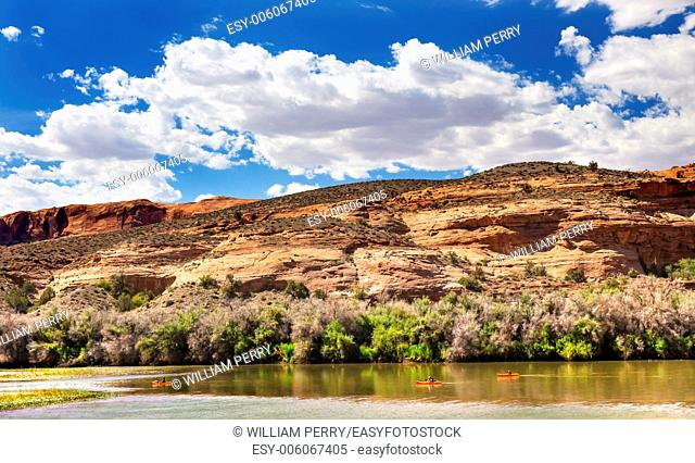 Orange Boats Colorado River Reflection Green Grass Red Rock Canyon Outside Arches National Park Moab Utah USA Southwest