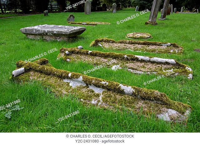 UK, England, Yorkshire. Gravestones in the Cemetery of St. Oswald's Church, Built around 1200 A. D