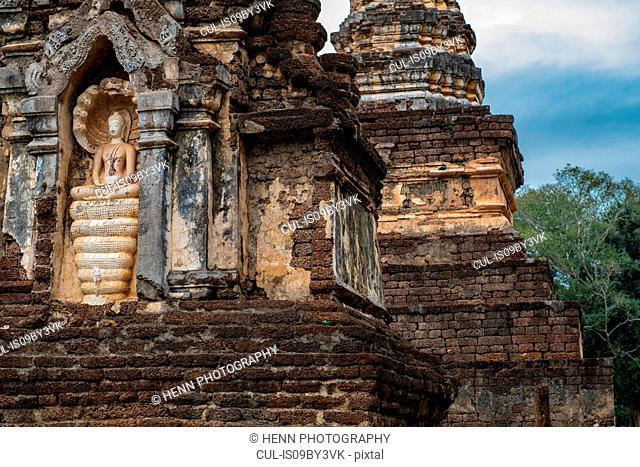 Ancient buddhist temple and statue, detail, Sukhothai historical park, Sukhothai, Thailand
