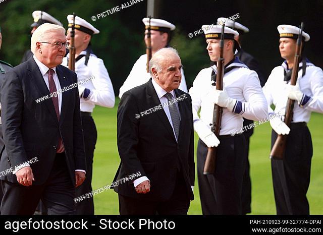 23 September 2021, Berlin: German President Frank-Walter Steinmeier (l) receives Malta's President George William Vella with military honours in the garden of...