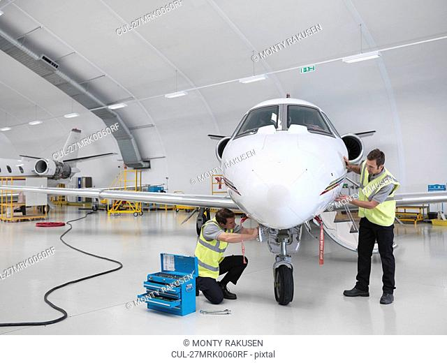 Engineers working on jet aircraft