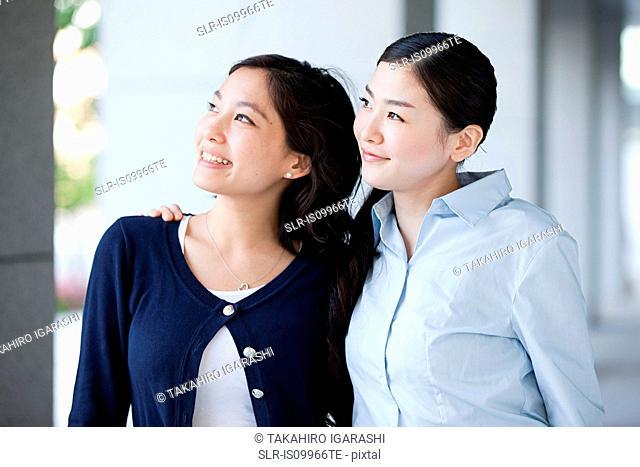 Two businesswomen looking away