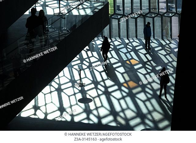 Silhouettes in the Harpa Concert Hall and Conference Centre in Reykjavic, Iceland