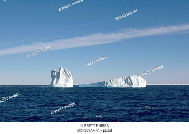 Icebergs amongst the ice floe in the southern ocean, 180 miles north of East Antarctica, Antarctica