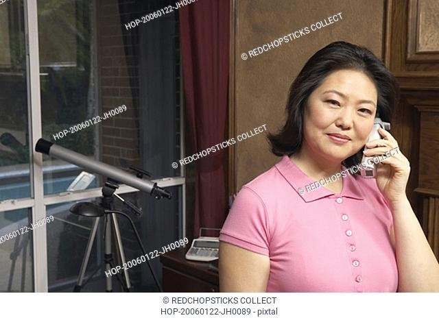 Portrait of a mature woman talking on a cordless telephone