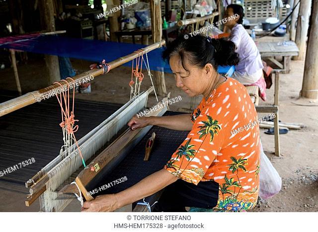 Thailand, Northeastern Thailand, Isan region, Chonnabot district, woman weaving the mat mii dyeing the threads of silk before weaving