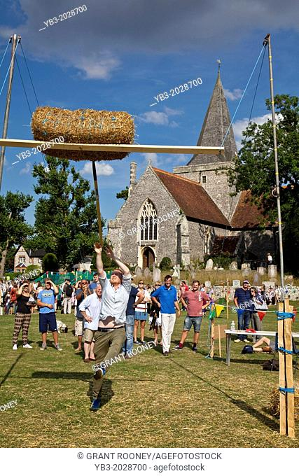 Hay Bale Tossing, The Alfriston Festival, Sussex, England