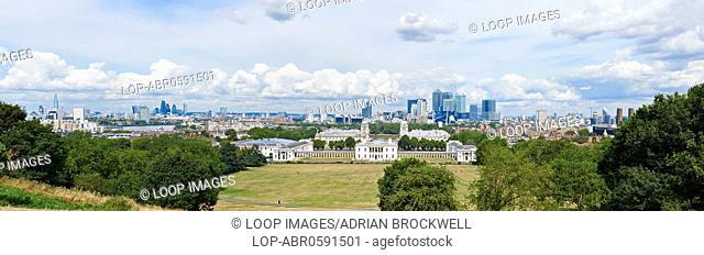 Panoramic view of the City of London behind National Maritime Museum in Greenwich park