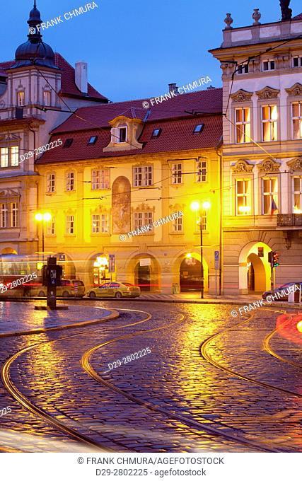 Prague - cars and tramways at Malostranske Square at dusk