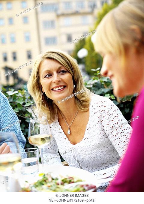 Two women in an open-air restaurant