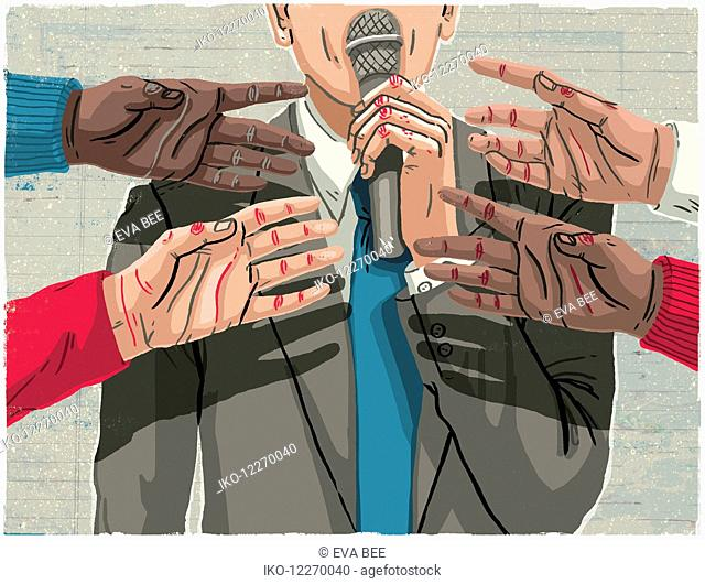 Hands reaching for microphone held by man in suit