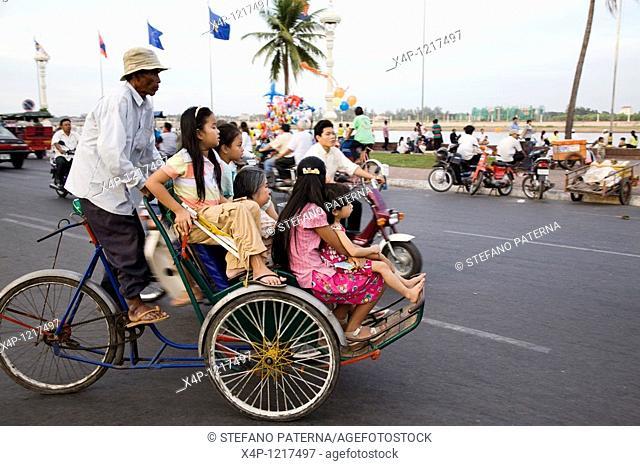 Family on Cyclo in Phnom Penh, Cambodia