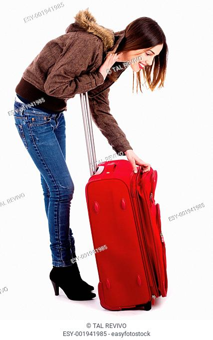 young woman searching her baggage