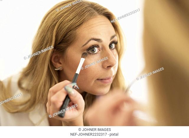Woman doing make-up