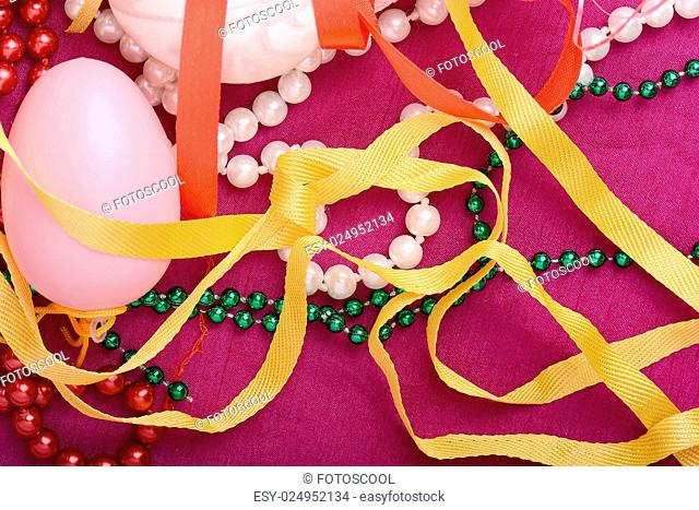 Easter background with eggs, ribbons and spring decoration