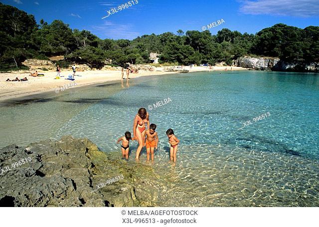 Family in beach or Cala Turqueta  Minorca  Balearic islands  Spain
