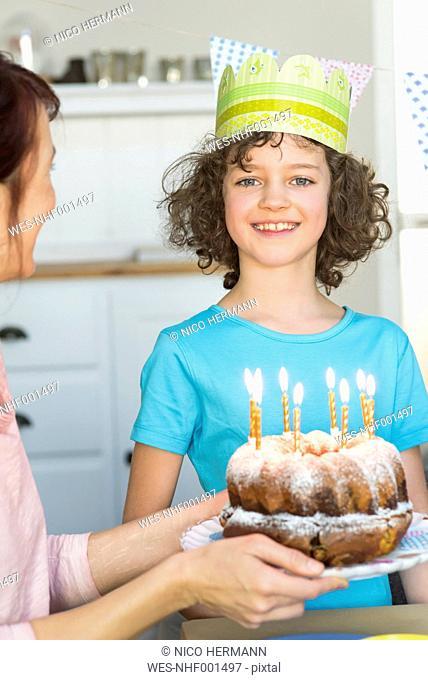 Girl receiving birthday cake