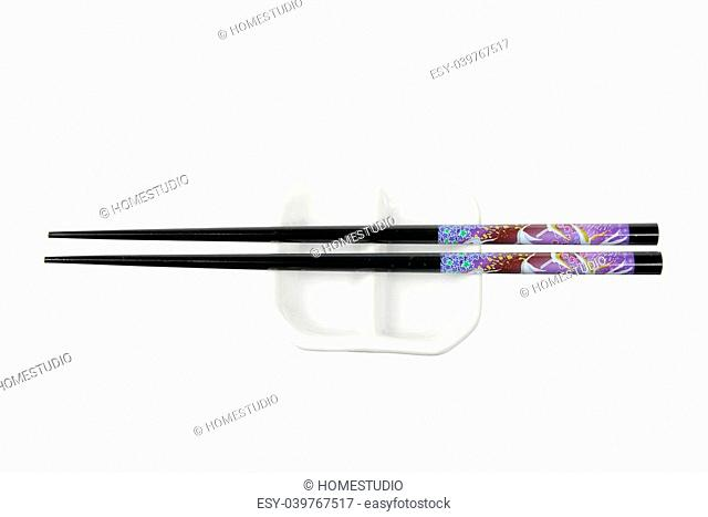 Chopsticks and Sauce Dish on White Background