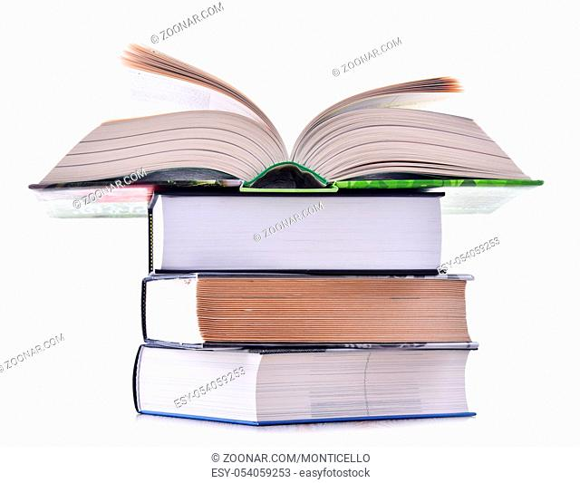 Composition with stack of books isolated on white