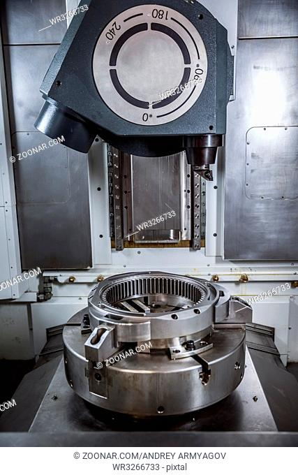 Metalworking CNC milling machine. Cutting metal modern processing technology. Small depth of field. Warning - authentic shooting in challenging conditions