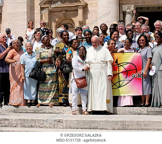 St. Peter's square. Pope Francis in front of the basilica with a group of pilgrims who came for the General Audience on the occasion of the Jubilee of Mercy...