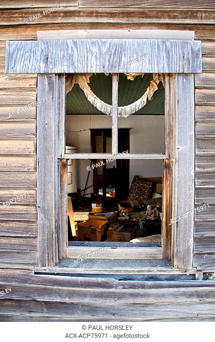 Window frame and tattered curtain, abandoned farmhouse, Alberta, Canada