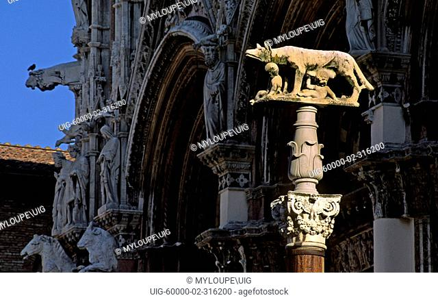 Stone carving on ROMULUS & REMUS with wolf mother stand on a pillar in front of SIENA'S CATHEDRAL - TUSCANY, ITALY