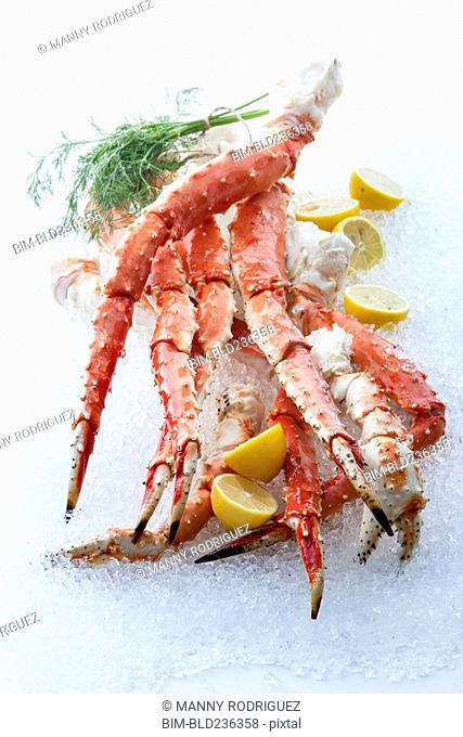 Crab legs and lemons on ice