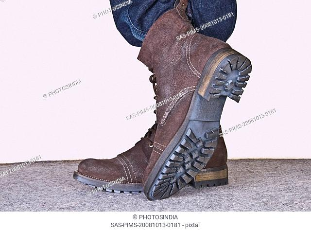 Low section view of a person wearing hiking boots