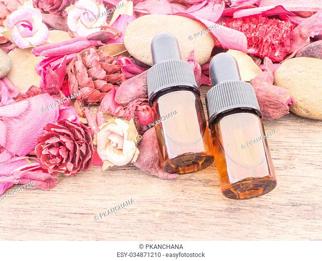 Dropper bottle with red potpourri dried flower for spa Background
