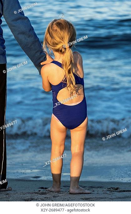 Girl plays at the beach, Cape Cod, Massachusetts, USA