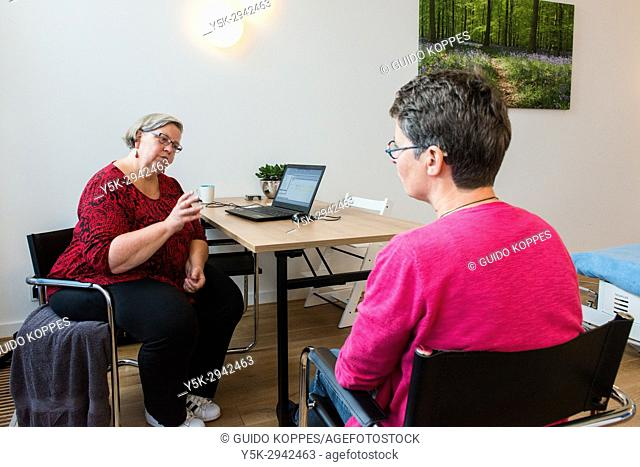 Tilburg, Netherlands. Mature adult woman attending physiotherapy and physical coaching