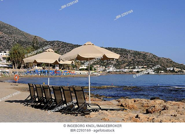 Deck chairs, parasols, beach, Malia, Crete, Greece, Europe