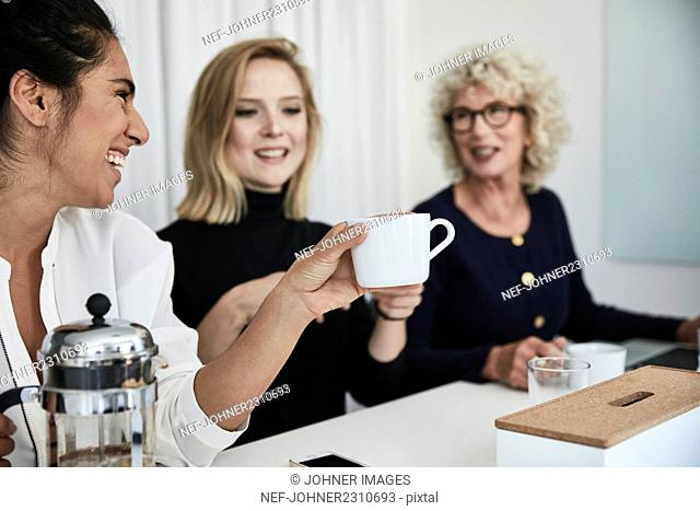 Women with coffee cup during business meeting