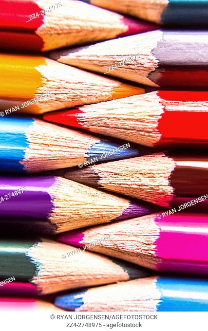 Colouring in pencils interlinked in a closeup macro still life photo. Colors entwined
