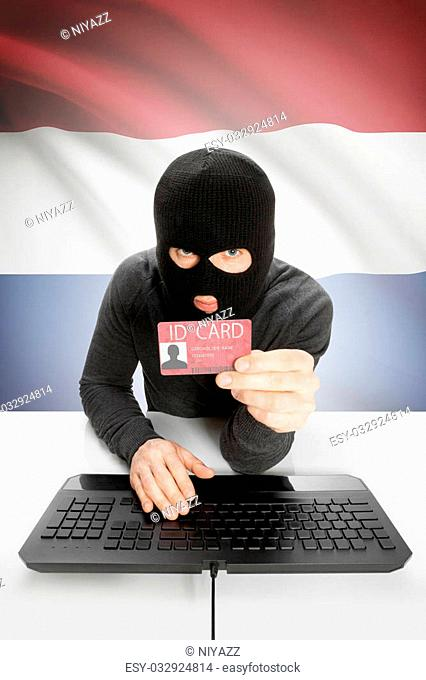 Hacker with ID card in hand and flag on background - Netherlands