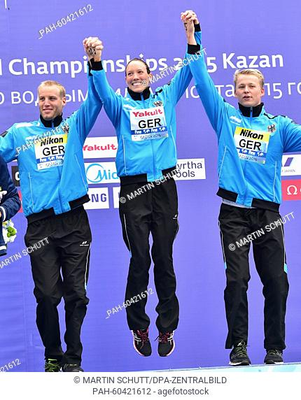 Christian Reichert (L-R), Isabelle Haerle and Rob Muffels of Germany celebrate after winning the 5 km Open Water Team event of the 16th FINA Swimming World...