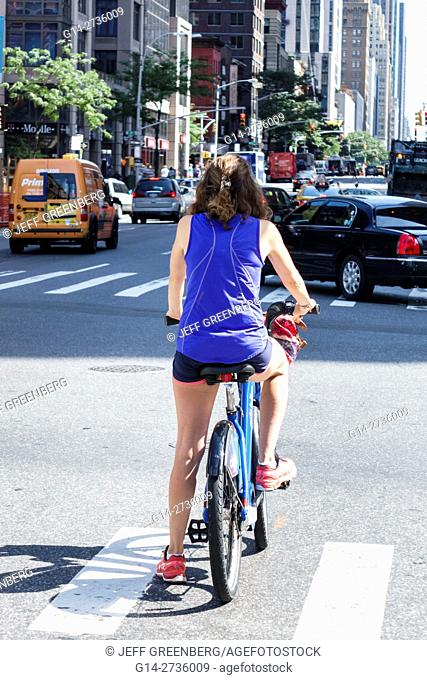 New York, New York City, NYC, Manhattan, Chelsea, 6th, Sixth Avenue, street traffic, woman, bicycle, cycle, stopped, intersection, car
