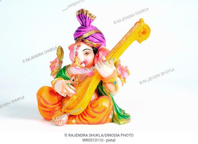 Statue of lord ganesh playing veena , India