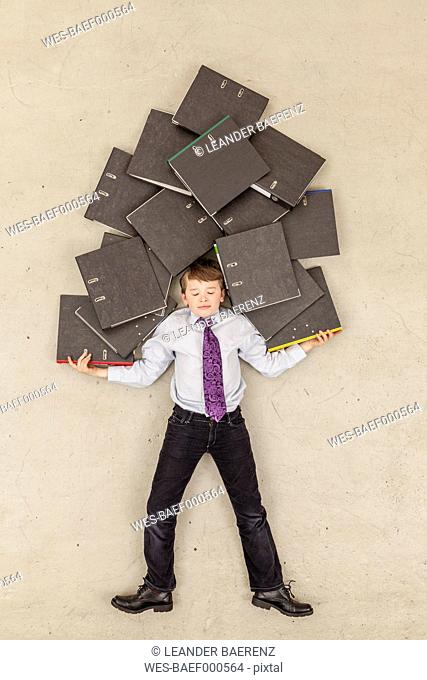 Business boy holding stack of files