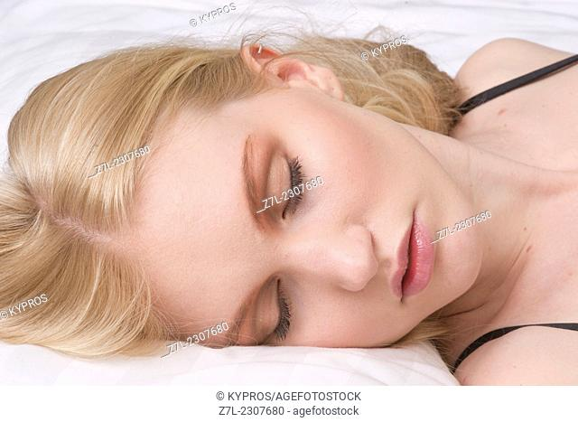 Close-up of sleeping young woman
