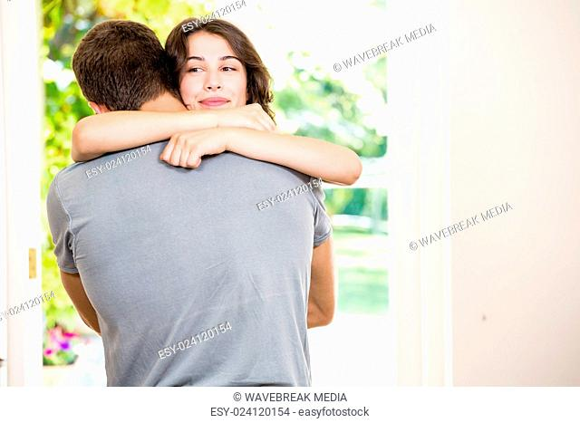 Young couple embracing each other