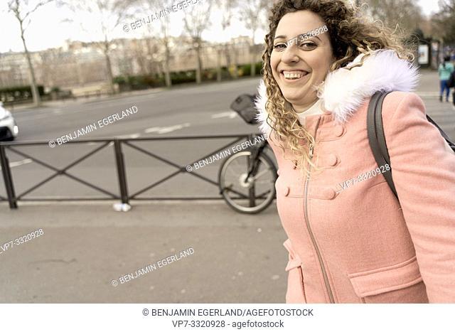 happy woman walking at street, in Paris, France