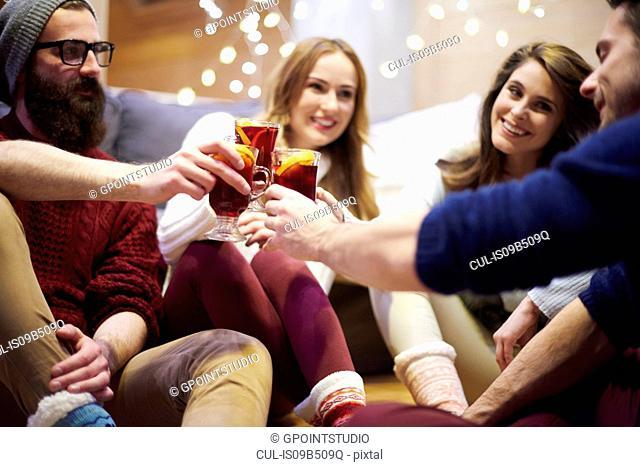 Friends enjoying mulled wine in chalet